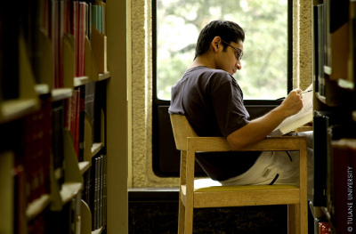 student studying among the stacks